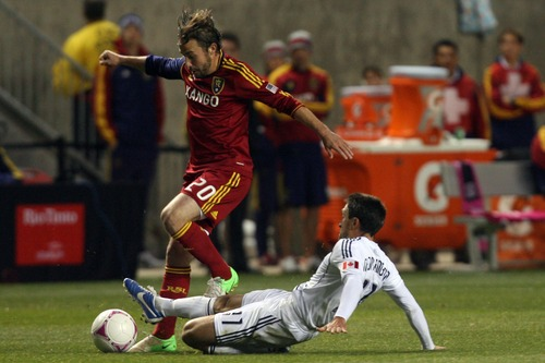 Kim Raff | The Salt Lake Tribune (left) Real Salt Lake midfielder Ned Grabavoy (20) tries to keep possession as Vancouver FC midfielder John Thorrington (11) tries a slide tackle during a game at Rio Tinto Stadium in Sandy, Utah on October 27, 2012.