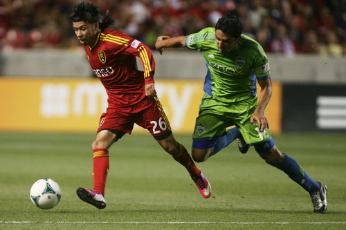 Kim Raff  |  The Salt Lake Tribune (left) Real Salt Lake midfielder Sebastian Velasquez (26) looks to pass as (right) Seattle Sounders FC defender Leo Gonzalez (12) trails behind during the second half at Rio Tinto Stadium in Sandy on June 22, 2013.