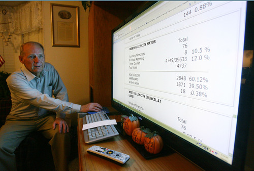 Steve Griffin  |  The Salt Lake Tribune   West Valley City mayor candidate Ron Bigelow, refreshes the election results website on his television at his home in  West Valley City, Utah Tuesday, November 5, 2013. Bigelow followed the election results from his home with family, friends and supporters.