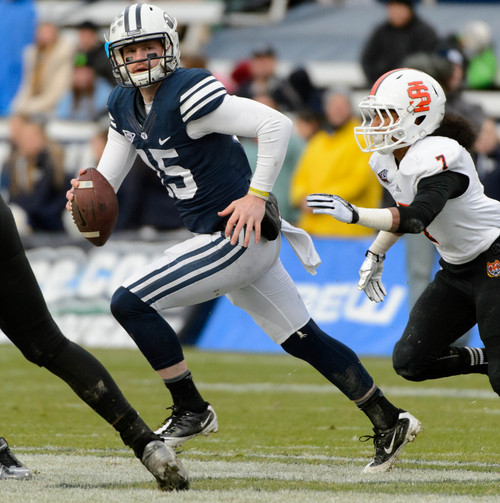 Trent Nelson     The Salt Lake Tribune Brigham Young Cougars quarterback Ammon Olsen (15) scrambles as BYU hosts Idaho State, college football at LaVell Edwards Stadium in Provo, Saturday November 16, 2013.