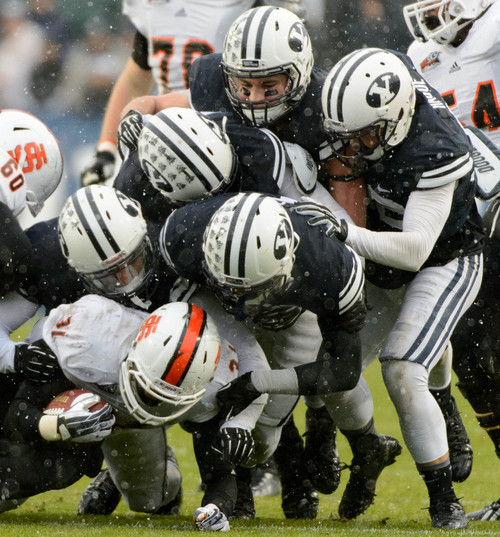 Trent Nelson     The Salt Lake Tribune Idaho State Bengals running back Xavier Finney (31) is brought down by BYU defenders as BYU hosts Idaho State, college football at LaVell Edwards Stadium in Provo, Saturday November 16, 2013.