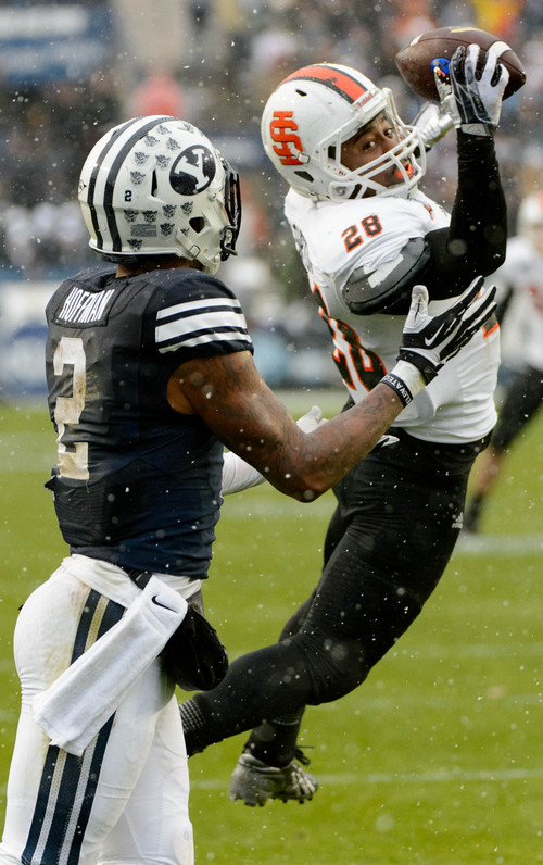 Trent Nelson     The Salt Lake Tribune Idaho State Bengals defensive back Cameron Gupton (28) intercepts a pass intended for Brigham Young Cougars wide receiver Cody Hoffman (2), as BYU hosts Idaho State, college football at LaVell Edwards Stadium in Provo, Saturday November 16, 2013.