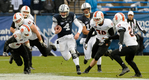 Trent Nelson     The Salt Lake Tribune Brigham Young Cougars quarterback Taysom Hill (4) runs the ball as BYU hosts Idaho State, college football at LaVell Edwards Stadium in Provo, Saturday November 16, 2013.