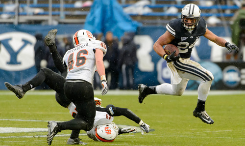 Trent Nelson     The Salt Lake Tribune Brigham Young Cougars running back Algernon Brown (24) runs the ball as BYU hosts Idaho State, college football at LaVell Edwards Stadium in Provo, Saturday November 16, 2013.