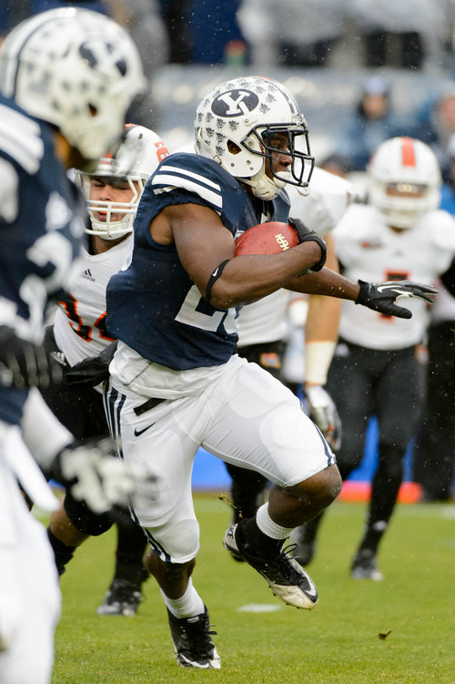 Trent Nelson     The Salt Lake Tribune Brigham Young Cougars running back Adam Hine (28) runs the ball as BYU hosts Idaho State, college football at LaVell Edwards Stadium in Provo, Saturday November 16, 2013.