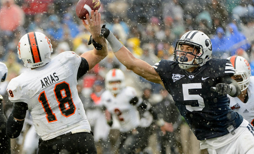Trent Nelson     The Salt Lake Tribune Brigham Young Cougars linebacker Alani Fua (5) gets a hand on a pass by Idaho State Bengals quarterback Justin Arias (18), which was returned for a touchdown by Brigham Young Cougars defensive lineman Bronson Kaufusi (90) as BYU hosts Idaho State, college football at LaVell Edwards Stadium in Provo, Saturday November 16, 2013.