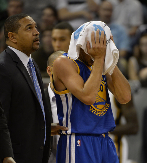 Rick Egan    The Salt Lake Tribune   Golden State Warriors point guard Stephen Curry (30) is helped off of the court by coach Mark Jackson, after colliding with Utah Jazz power forward Marvin Williams (2), in NBA action, The Utah Jazz vs. The Golden State Warriors, at the EnergySolutions Arena, Monday, November 18, 2013.  Curry did not return to the game after the play.