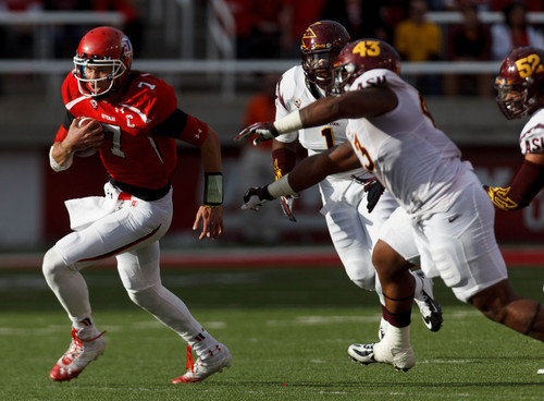 Trent Nelson  |  The Salt Lake Tribune Utah Utes quarterback Travis Wilson (7) runs the ball as the University of Utah hosts Arizona State, college football at Rice-Eccles Stadium in Salt Lake City, Saturday November 9, 2013.