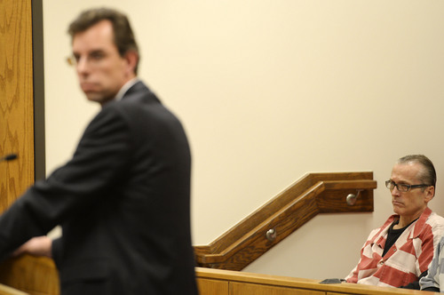Steve Griffin     The Salt Lake Tribune   Martin MacNeill, right, sits in the jury box as he listens to his defense attorney, Randall Spencer, in Judge Samual McVey's courtroom at the Provo District Court in Provo, Utah Monday, November 18, 2013. MacNeill is accused of  putting his hand down the pants of an adult female relative and asking her to sign a statement saying he did not touch her. Case was originally dismissed in 2008 and refiled in 2009.