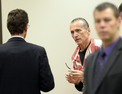 Steve Griffin     The Salt Lake Tribune   Martin MacNeill, talks with his defense attorney, Randall Spencer, in Judge Samual McVey's courtroom at the Provo District Court in Provo, Utah Monday, November 18, 2013. MacNeill is accused of putting his hand down the pants of an adult female relative and asking her to sign a statement saying he did not touch her. Case was originally dismissed in 2008 and refiled in 2009.