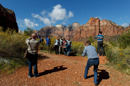 Trent Nelson  |  The Salt Lake Tribune Visitors to Zion National Park take in the sights after the park opened on a limited basis Friday, October 11, 2013.