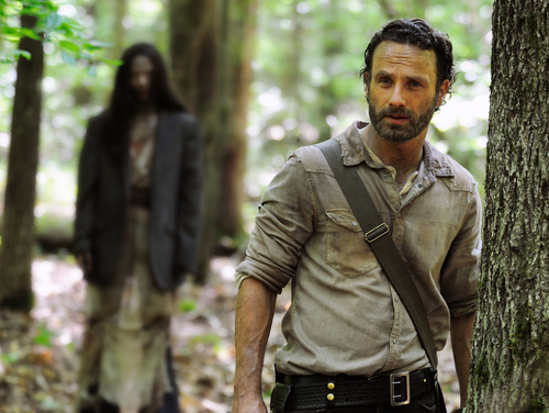 """This image released by AMC shows Andrew Lincoln as Rick Grimes in a scene from the season four premiere of """"The Walking Dead.""""  (AP Photo/AMC, Gene Page)"""