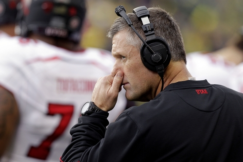 Utah coach Kyle Whittingham looks towards the scoreboard during a timeout in the first half of an NCAA college football game against Oregon in Eugene, Ore., Saturday, Nov. 16, 2013. (AP Photo/Don Ryan)