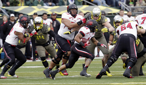 Utah running back Lucky Radley (44) races to turn the corner during the first half of an NCAA college football game against Oregon in Eugene, Ore., Saturday, Nov. 16, 2013. (AP Photo/Don Ryan)