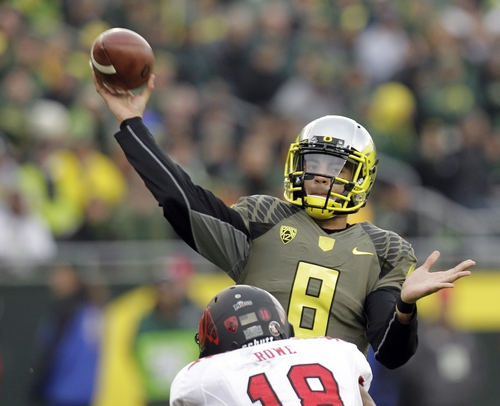 Oregon quarterback Marcus Mariota passes during the second half of an NCAA college football game against Utah in Eugene, Ore., Saturday, Nov. 16, 2013.  Mariota passed for 288 yards and three touchdowns as Oregon won 44-21. (AP Photo/Don Ryan)