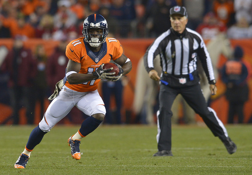 Denver Broncos wide receiver Trindon Holliday (11) returns a punt against the Kansas City Chiefs in the first quarter of an NFL football game, Sunday, Nov. 17, 2013, in Denver. (AP Photo/Jack Dempsey)