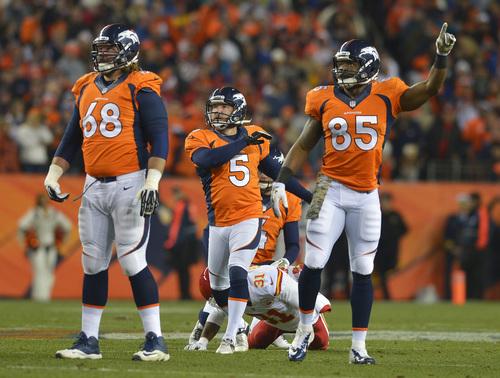 Denver Broncos kicker Matt Prater (5) follows through on a field goal against the Kansas City Chiefs in the first quarter of an NFL football game, Sunday, Nov. 17, 2013, in Denver. (AP Photo/Jack Dempsey)