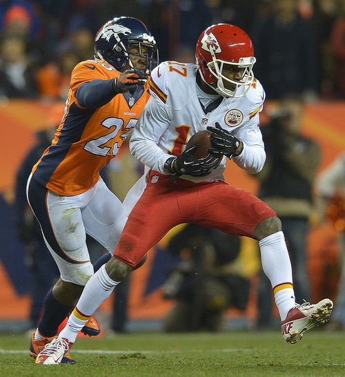 Kansas City Chiefs wide receiver Donnie Avery (17) comes down with a pass against Denver Broncos cornerback Quentin Jammer (23) in the fourth quarter of an NFL football game, Sunday, Nov. 17, 2013, in Denver. (AP Photo/Jack Dempsey)