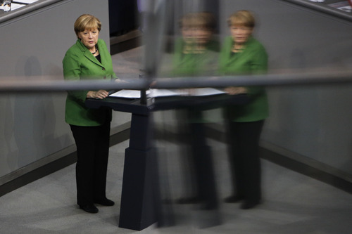 """German Chancellor Angela Merkel delivers her speech  at the German parliament Bundestag in Berlin, Monday, Nov. 18, 2013. German Chancellor Angela Merkel says the relationship between Germany and the United States as well as the future of a transatlantic free trade agreement have been """"put to the test"""" by allegations of massive spying by the U.S. National Security Agency. During a statement Monday to Parliament, Merkel called the allegations about NSA spying """"grave"""" and said they must be investigated to re-establish trust. At the same time, Merkel said the alliance with Washington """"remains a fundamental guarantor for our freedom and our security."""" The reflections are in windows at the visitors tribune (AP Photo/Markus Schreiber)"""