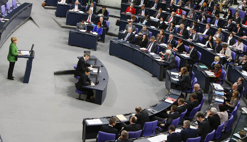 German Chancellor Angela Merkel delivers her speech about European policy and the German  relationship to the United States during a debate at the German parliament Bundestag in Berlin, Monday, Nov. 18, 2013.   (AP Photo/Markus Schreiber)