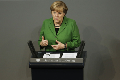 """German Chancellor Angela Merkel delivers her speech  at the German parliament Bundestag in Berlin, Monday, Nov. 18, 2013. German Chancellor Angela Merkel says the relationship between Germany and the United States as well as the future of a transatlantic free trade agreement have been """"put on test"""" by allegations of massive spying by the U.S. National Security Agency. During a statement Monday to Parliament, Merkel called the allegations about NSA spying """"grave"""" and said they must be investigated to re-establish trust. At the same time, Merkel said the alliance with Washington """"remains a fundamental guarantor for our freedom and our security."""" (AP Photo/Markus Schreiber)"""