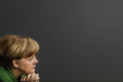 German Chancellor Angela Merkel listens to the debate about the European policy and the German relationship to the United States during a meeting of  the German parliament, Bundestag, in Berlin, Monday, Nov. 18, 2013.  (AP Photo/Markus Schreiber)
