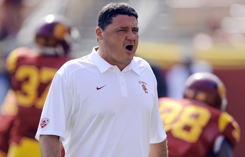 FILE - In this Oct. 26, 2013, file photo, Southern California head coach Ed Orgeron watches his players warm up before the start of an NCAA college football game against Utah in Los Angeles. Orgeron has injected fun back into USC, and victories have followed. The Trojans' 4-1 resurgence under their interim coach leads them into a Coliseum visit from No. 5 Stanford, which is two wins away from the chance to host the Pac-12 title game.(AP Photo/Gus Ruelas, File)