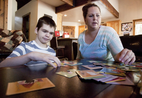 Steve Griffin | The Salt Lake Tribune  Jennifer May builds puzzles with her son, Stockton, at their .Pleasant Grove, Utah, home on Tuesday Aug. 27, 2013.  Stockton, who has severe seizures, has tried 25 other treatments prescribed by doctors. Jennifer May now wants to try medical marijuana.