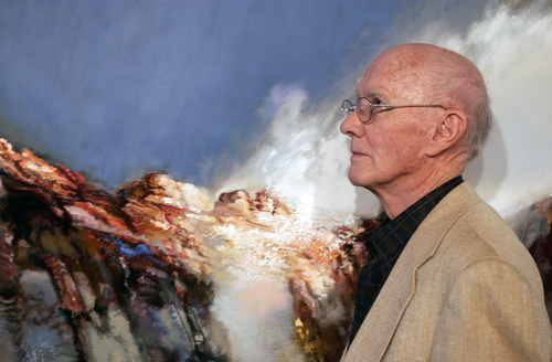 "Tribune file photo Artist Doug Snow in 2004 with his painting ""In Shinob Canyon."""