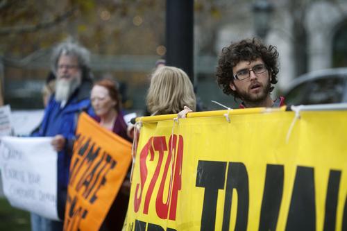 Jim McAuley | The Salt Lake Tribune Nathan Goodman protests the Trans-Pacific Partnership talks outside of the Grand American Hotel in Salt Lake City on Tuesday, November 19, 2013.