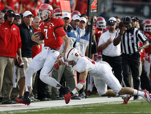Scott Sommerdorf   |  The Salt Lake Tribune Utah QB Travis Wilson is forced out of bounds after gaining a first down by Stanford Cardinal safety Ed Reynolds (29) during first half play. Utah upset #5 Stanford 27-21, Saturday, October 12, 2013.