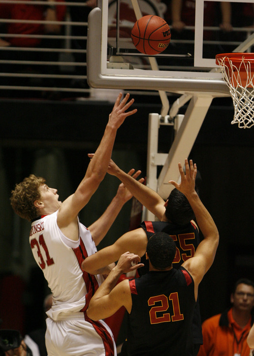 Rick Egan  |  Tribune file photo   Utah Utes center Dallin Bachynski (31) shoots as USC Trojans center Omar Oraby (55) defends in a January 2013 game. Bachynski, who has been injured with a sprained ankle, practiced with the Utes for the first time in two weeks Monday.