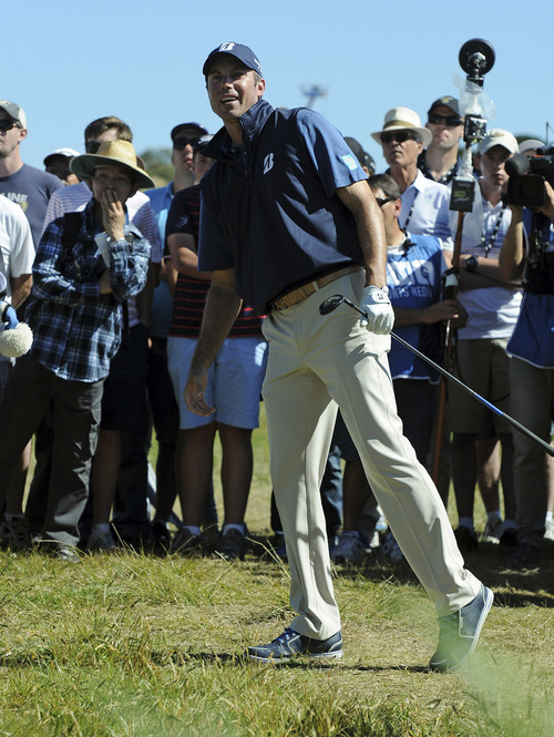 Matt Kuchar of the U.S. checks the flight of his ball during the final round of the Australian Masters golf tournament at Royal Melbourne Golf Course in Australia, Sunday, Nov. 17, 2013.  Kuchar finished second to Australia's Adam Scott. (AP Photo/Andy Brownbill)