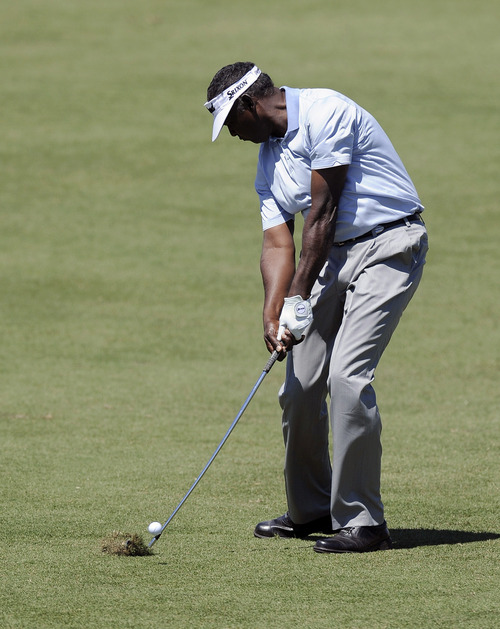 Vijay Singh from Fiji hits an approach shot during the final round of the Australian Masters golf tournament at Royal Melbourne Golf Course in Australia, Sunday, Nov. 17, 2013.  (AP Photo/Andy Brownbill)