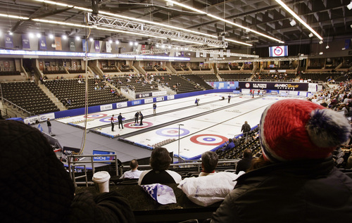 Competitors play at the U.S. Olympic curling trials Saturday, Nov. 16, 2013, in Fargo, N.D. (AP Photo/Dave Wallis/The Forum)