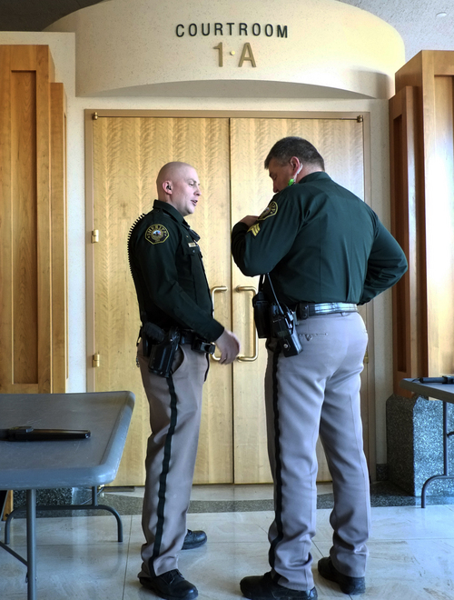 Jefferson County sheriff's deputies stand guard at the entrance to the district courtroom where the sentencing of Austin Sigg, 18, is underway in Golden, Colo., on Monday, Nov.18, 2013. Sigg pleaded guilty last month to kidnapping and killing Jessica Ridgeway in Westminster in October 2012.  Ridgeway was abducted while walking to school, and human remains identified as hers were found five days later in a park. More of her remains were hidden in a crawl space in Sigg's mother's home, where he lived.  (AP Photo/Ed Andrieski)