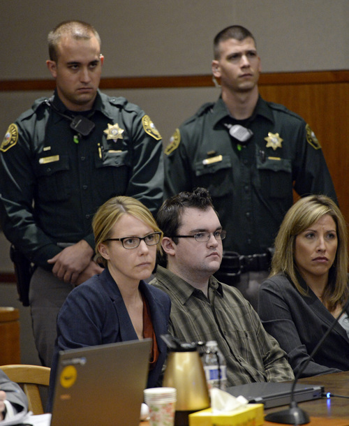 Sheriff's deputies stand behind Austin Sigg, fronr center, as he sits in district court in Golden, Colo., on Tuesday, Nov. 19, 2013, during his sentencing hearing. Sigg, 18, who killed and dismembered 10-year-old Jessica Ridgeway in October 2012 was ordered Tuesday to spend the rest of his life in prison. He would have been eligible for parole on the murder charge in 40 years because he was a juvenile at the time, but the judge added on sentences for other crimes that Sigg pleaded guilty to, eliminating that possibility. (AP Photo/Denver Post, RJ Sangosti, Pool)