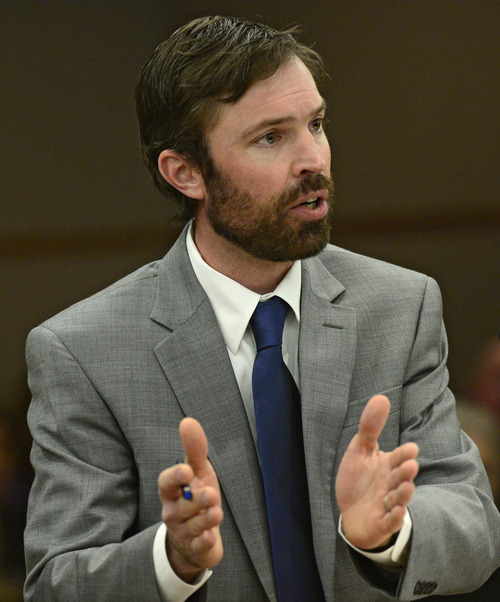 Ryan Loewer, defense attorney for Austin Sigg, addresses the court in Golden, Colo., on Tuesday, Nov.19, 2013. District Judge Stephen Munsinger sentenced Austin Sigg to life plus 86 years for the killing of Jessica Ridgeway.  (AP Photo/Denver Post, RJ Sangosti, Pool)