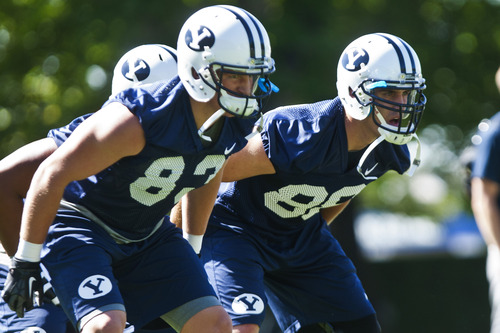 Chris Detrick  |  The Salt Lake Tribune BYU's Austin Holt, right, and Stehly Reden, during a preseason practice at the BYU outdoor practice field Thursday August 2, 2012.