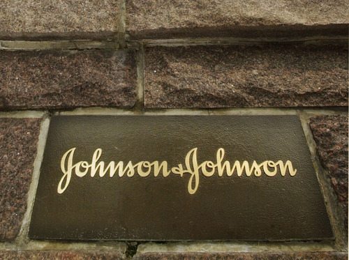 FILE - This file photo made July 19, 2002, shows the Johnson & Johnson corporate headquarters in New Brunswick, N.J.  Johnson & Johnson said Tuesday, Noov. 19, 2013,  it will pay $2.5 billion to settle thousands of lawsuits brought by hip replacement patients who accuse the company of selling faulty implants that led to injuries and additional surgeries. (AP Photo/Daniel Hulshizer, File)