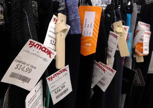 In the Monday, Sept. 23, 2013, photo, price tags hang on merchandise at T.J. Maxx in North Andover, Mass. The government reports on consumer prices for October on Wednesday, Nov. 20, 2013.(AP Photo/Elise Amendola)