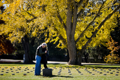 Tom Stack and Jill MacKenzie pay their respects at a stone marking the resting place of some  of the unknown dead from the battle of Gettysburg, at Soldiers' National Cemetery Monday, Nov. 18, 2013, in Gettysburg, Pa. Nov. 19th marks the 150th anniversary of President Abraham Lincoln's short speech that has gone on to symbolize his presidency and explain the sacrifices made by Union and Confederate forces during the U.S. Civil War.  (AP Photo/Matt Rourke)
