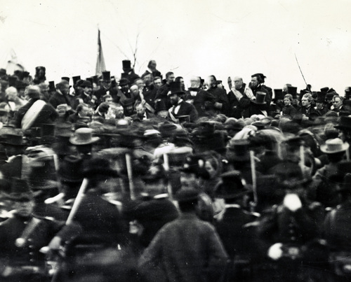 photo courtesy Library of Congress  President Abraham Lincoln is seen at the ceremony where he delivered the Gettysburg Address on Novemer 19, 1863. President Lincoln can be seen facing the camera, just above the center of the photo. He is not wearing a hat.