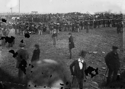 """This Nov. 19, 1863 photo made available by the Library of Congress shows the crowd assembled for President Abraham Lincoln's address at the dedication of a portion of the battlefield at Gettysburg, Pa. as a national cemetery. """"The battlefield, on that sombre autumn day, was enveloped in gloom,"""" Joseph Ignatius Gilbert, a freelancer for The Associated Press at the time, wrote in a paper delivered at the 1917 convention of the National Shorthand Reporters' Association in Cleveland. """"Nature seemed to veil her face in sorrow for the awful tragedy enacted there."""" (AP Photo/Library of Congress, Alexander Gardner)"""