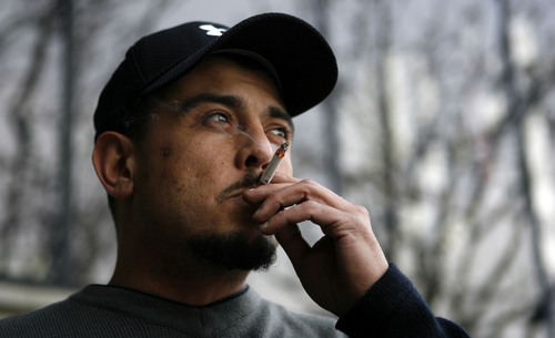 Murray - Mike Renteria who is very passionate about smokers' rights and is opposed to increasing tax on cigarettes to remove tax on food, takes a recent smoke break from his job in Murray.  Photo by Francisco Kjolseth/The Salt Lake Tribune 01/26/2009