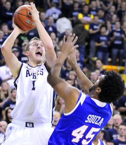Utah State forward Ben Clifford (1) shoots over Louisiana Tech center Romario Souza (45) during an NCAA college basketball game, Thursday, Feb. 9, 2012, in Logan, Utah. (AP Photo/The Herald Journal, Eli Lucero)
