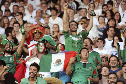 Mexico fans cheer in the World Cup soccer qualifier against New Zealand at Westpac Stadium in Wellington, New Zealand, Wednesday, Nov. 20, 2013. (AP Photo/SNPA, John Cowpland) NEW ZEALAND OUT