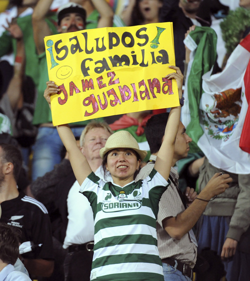 A Mexican fan cheers with a sign in the World Cup soccer qualifier against New Zealand at Westpac Stadium in Wellington, New Zealand, Wednesday, Nov. 20, 2013. (AP Photo/SNPA, John Cowpland) NEW ZEALAND OUT