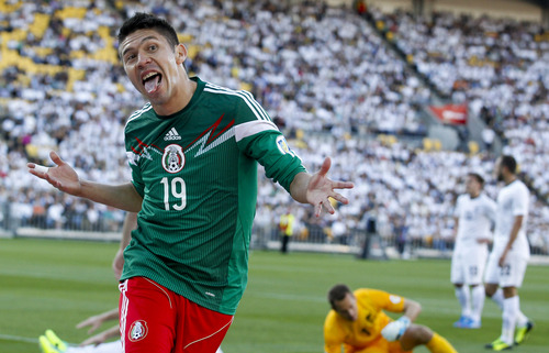 Mexico's Oribe Peralta celebrates a goal against New Zealand in their World Cup qualifying soccer match at Westpac Stadium in Wellington, New Zealand, Wednesday, Nov. 20, 2013. (AP Photo/SNPA, John Cowpland) NEW ZEALAND OUT