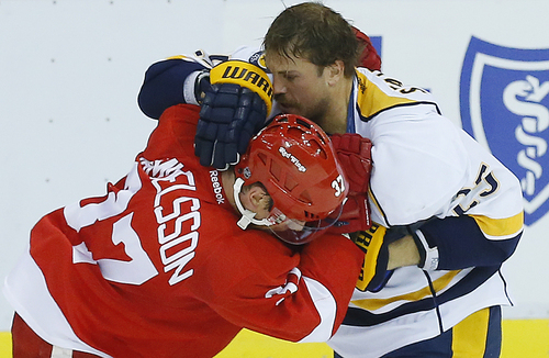 Detroit Red Wings right wing Mikael Samuelsson (37), of Sweden, and Nashville Predators left wing Viktor Stalberg (25), of Sweden, fight in the third period of an NHL hockey game in Detroit, Tuesday, Nov. 19, 2013. Nashville won 2-0. (AP Photo/Paul Sancya)